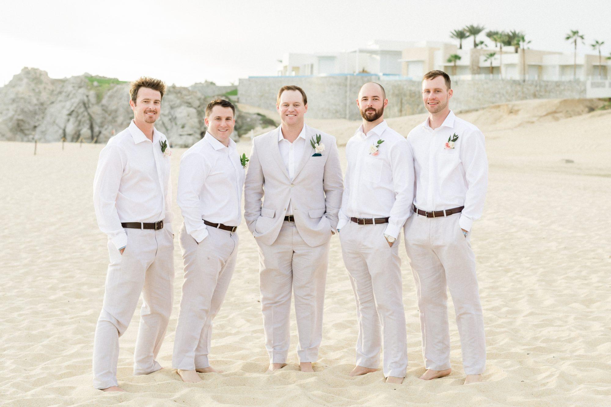 Groom and groomsmen at beachfront wedding